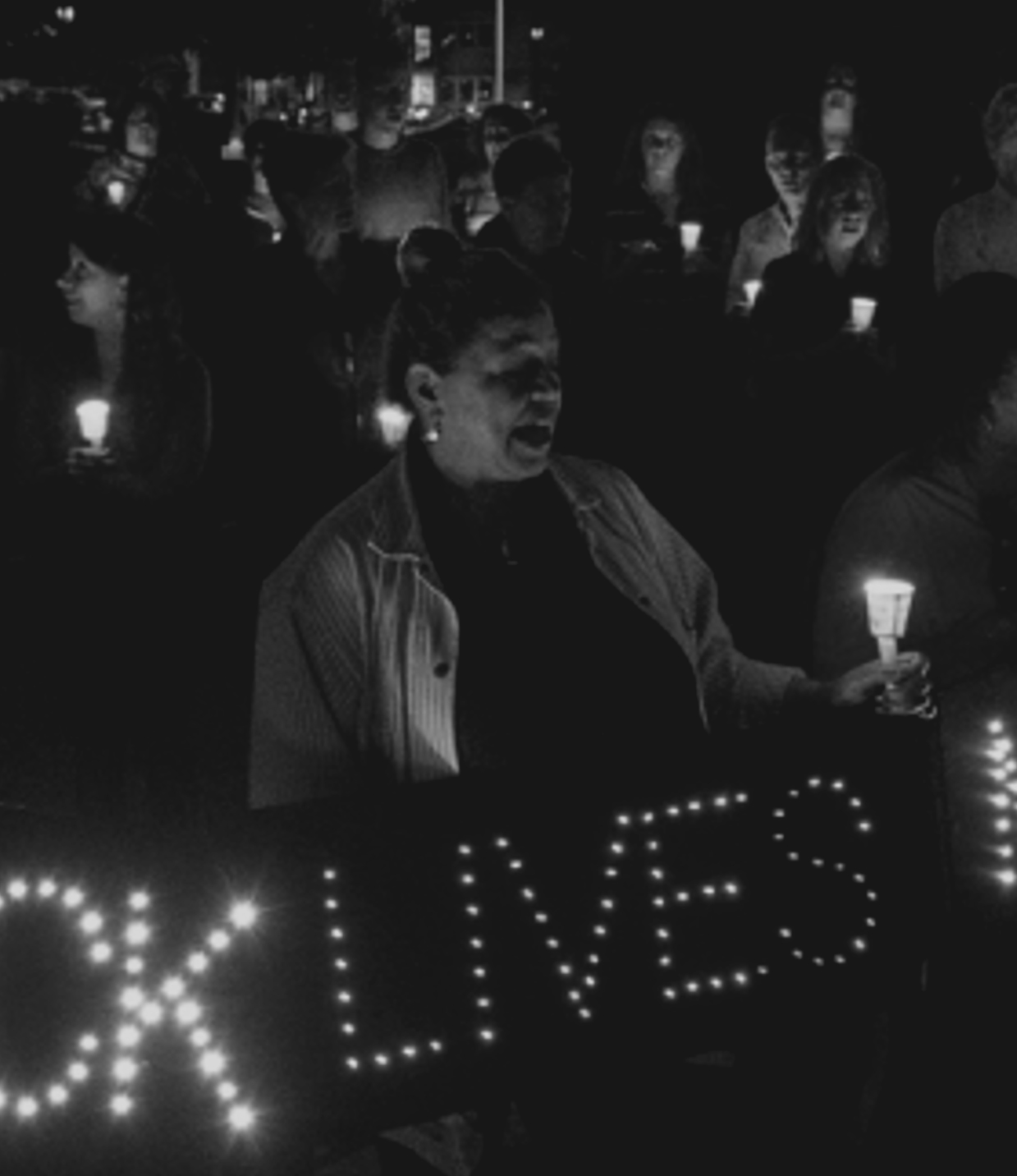BLACK & WHITE PHOTO OF CROWD OF PEOPLE AT A BLACK LIVES MATTER CANDLELIGHT SERVICE