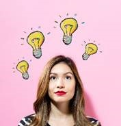 Image of woman whose head is surrounded by four illustrated lightbulbs signifying ideas