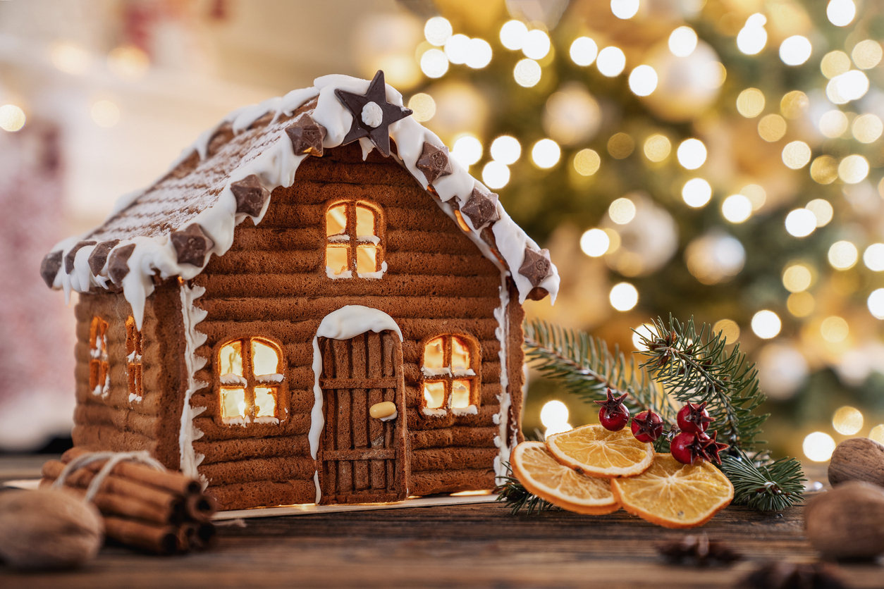 A gingerbread house with festive lights and decorations