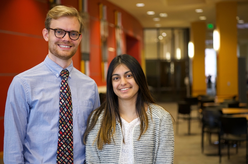 Students Suhani Chitalia and Michael Sikorski, third-year students at the Carey School of Law and the School of Medicine, respectively, pose for a photo.