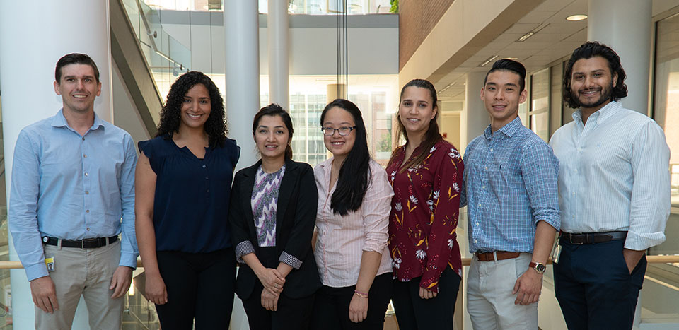 From left to right: Dr. Ryan Pearson; Melissa Metry; Asmita Adhikari; Angela Lee; Ana Coutinho; Bryan Eng; and Raqeeb Jamil.